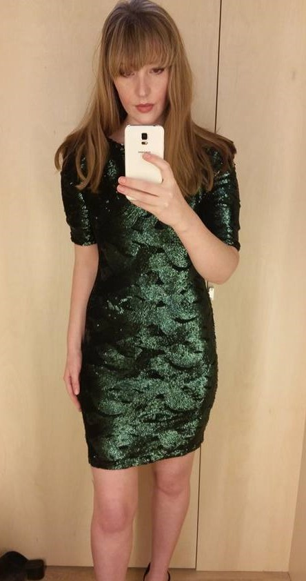 this sequin bodycon dress is surprisingly flattering it pulls you in at all the right places and is a perfect festive green
