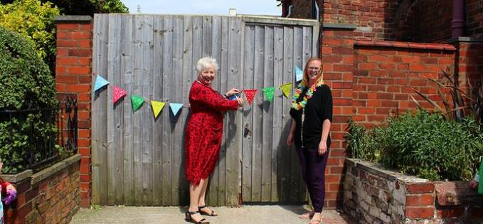 Caz mum cuts the bunting to declare the garden open (Pic: Heather Currie)