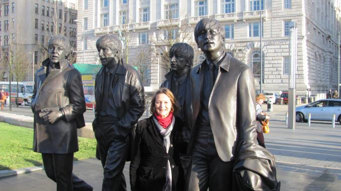 Julia Baird, John Lennons sister, is dwarfed by the figures at the unveiling