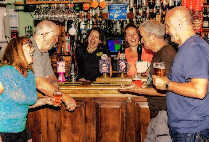 Drinkers at a Merseyside pub toast their choice for the next leader of the Labour Party