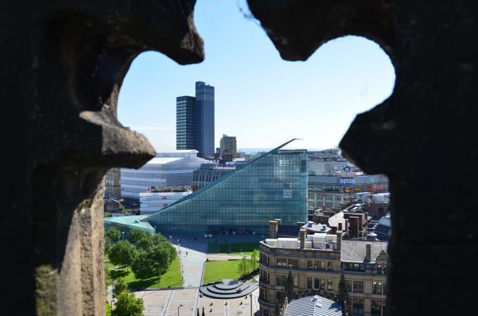 CIS Tower and National Football Museum through the openwork battlements