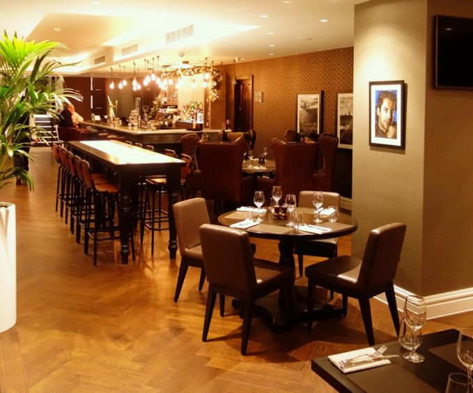 Airbrushed out: Brasserie Michelle three months ago with a portrait of Novelli on the wall