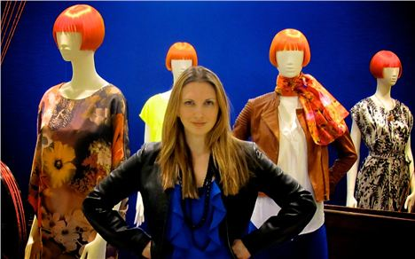 Karen Regn poses with Mary's mannequins