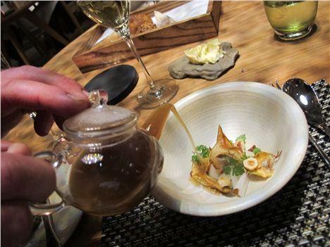 Artichoke broth with truffle dumplings, bacon, radish, hazelnut