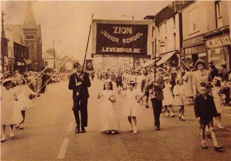 Stockport Road, Levenshulme, 1952. Lynda's Great Uncle to the left, holding a banner during the Whit Walks