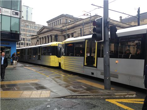 The offender tried to push the officer in front of tram