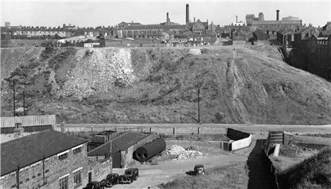 1950s scene showing the view back to the Improbable Hill from the Impossible Bridge