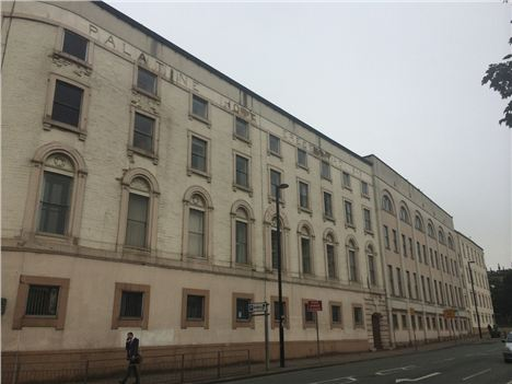 Palatine Building and its blank, mucked about with, facade