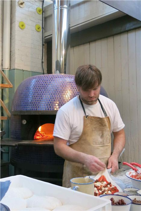 The warm glow of the Honest Crust pizza oven