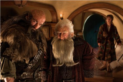 Parlour look-alike with dwarves and a hobbit